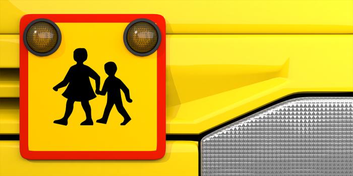 Illustrerad bild föreställande en skjolskjutsbuss