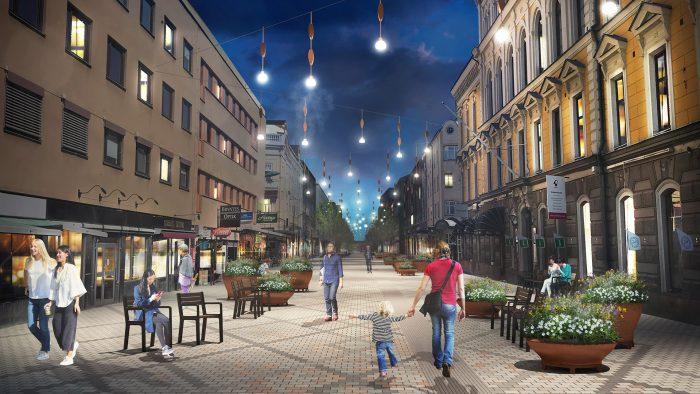 Kvällsvy över Drottninggatan med nya bänkar, blomsterurnor och lampor.