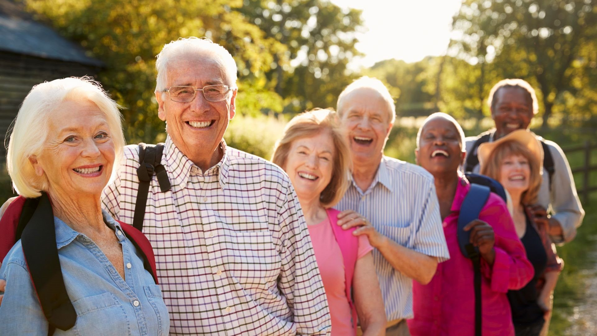 23593568-portrait-of-senior-friends-hiking-in-countryside_1920_1080