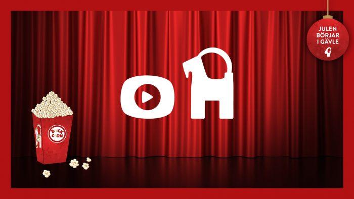Digital Bockinvigning, digital bocksymbol på röd röd bioduk, popcorn