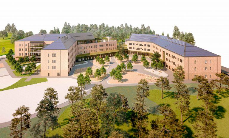 Hemlingborgs byggnad med tegelfasader, takterrass och grönskande innergård.