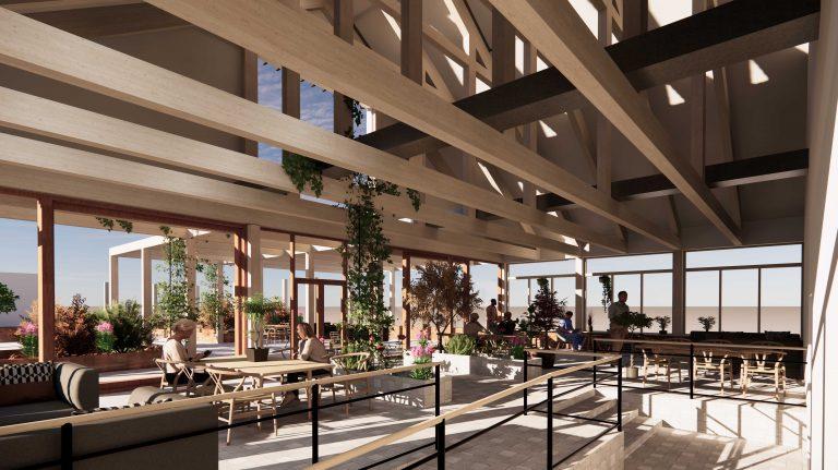 Del av Hemlingborgs takterrass med växter, soffor, bord och stolar.